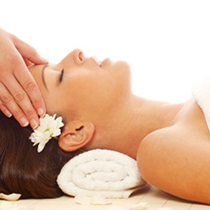 Guest enjoys a head massage, one of the luxury services at Domus Renier Boutique Hotel in Chania