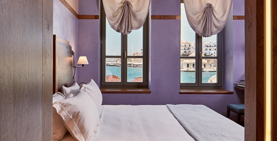 Queen Size bed in luxury Classic Double Rooms of Domus Renier Luxury Hotel in Chania port, Crete