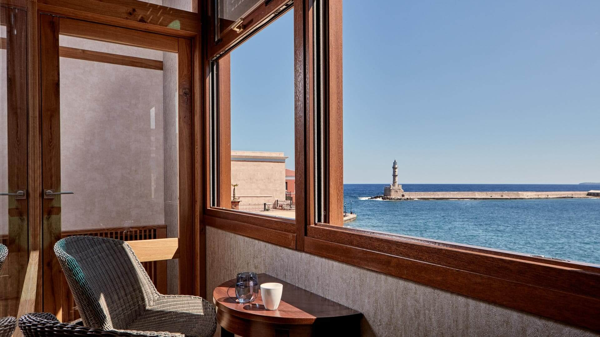 Chania harbour sea view from the oriel balcony of a luxury suite at Domus Renier Boutique Hotel