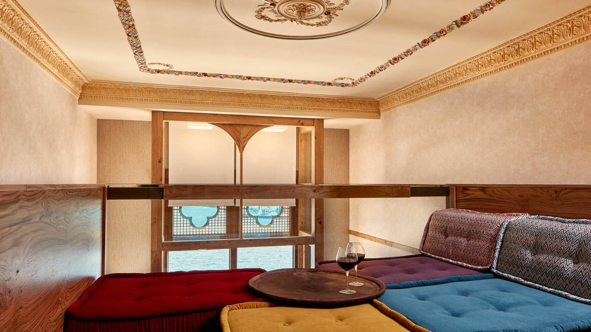 Loft space with sofa cushions in a luxury suite at the Domus Renier, a Chania Boutique Hotel