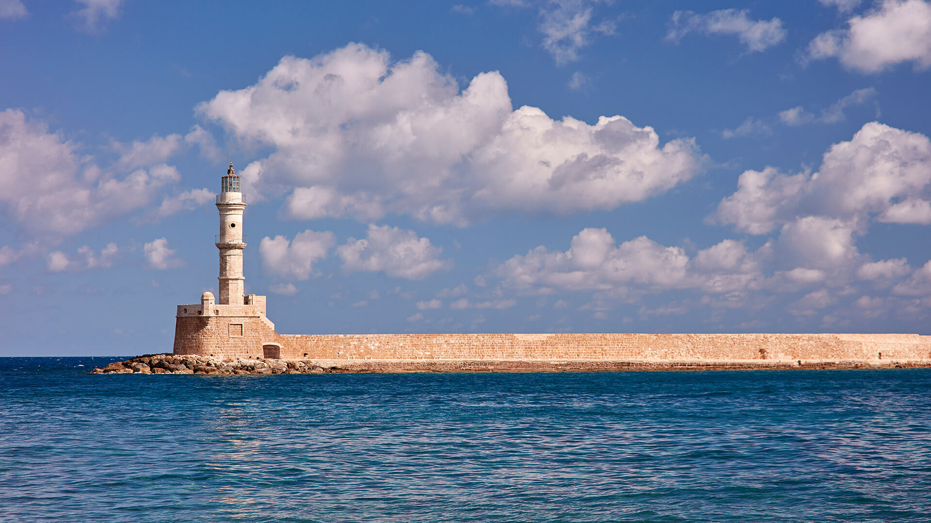 The lighthouse in Chania old town harbour is walking distance from Domus Renier Boutique Hotel