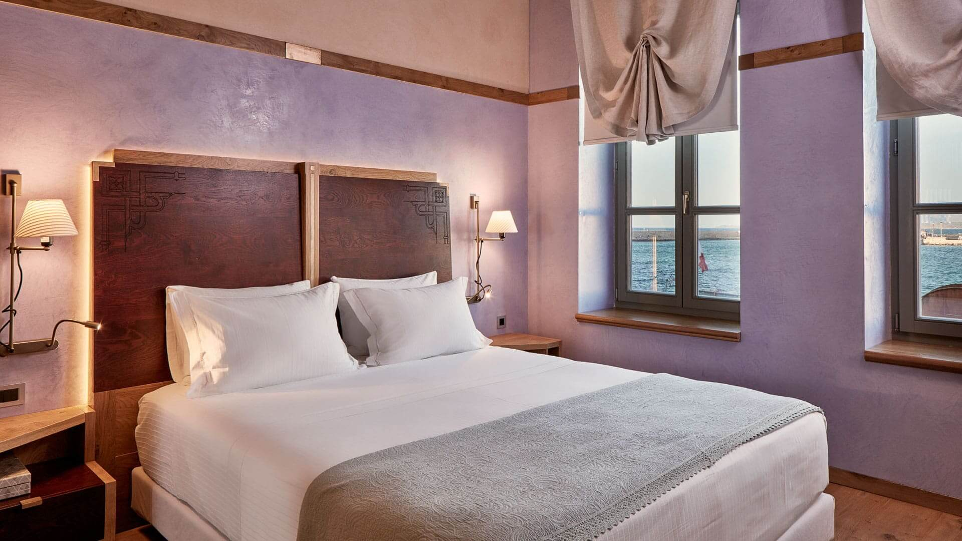 Queen size bed in one of the sea view rooms & suites at the Domus Renier Boutique Hotel Chania